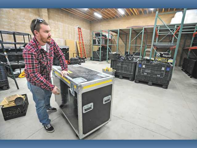 SOS Entertainment Production Manager Kyle Souther in a new 3500-square-foot warehouse in Canyon Country on Thursday.