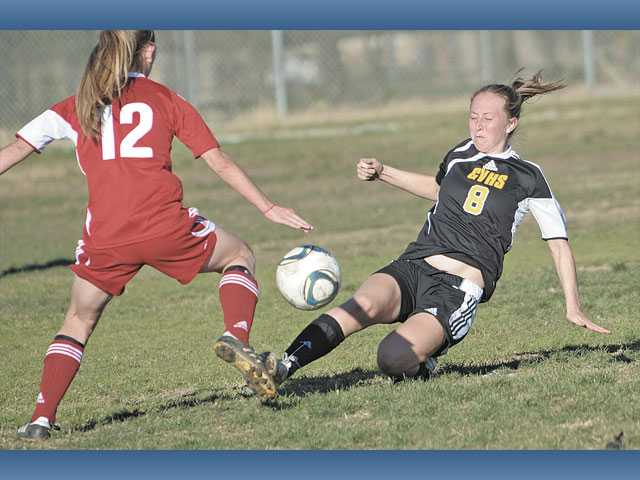 Golden Valley's Colleen Fleming (8) tackles the ball away from Paraclete's Lauren Parish during pool play at the Hart Soccer Showcase on Tuesday at Hart High.