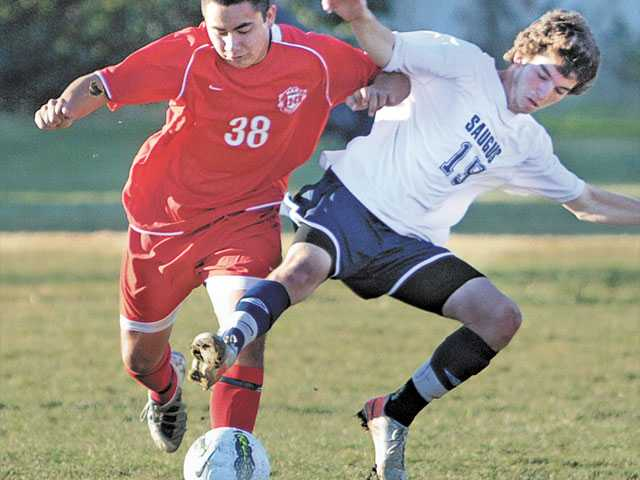 Hart's Osmar Martinez (38) and Saugus' Jordan Pacheco fight for possession of the ball during the Hart Soccer Showcase on Tuesday at Hart High School. The Indians beat the Centurions 2-0.