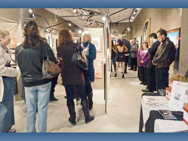 Guests visit the new Santa Clarita Artists' Association Art Gallery on Town Center Drive.