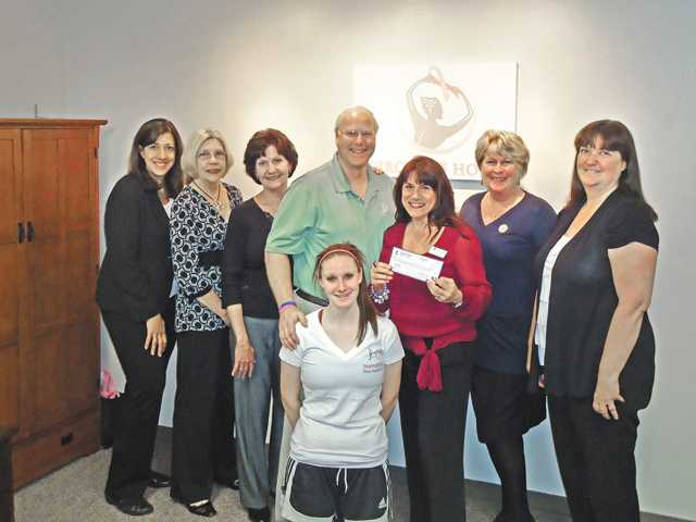 Soroptimist International of SCV President Sandi Naba, center, holding check, presents $5,500 raised from Bras for a Cause to Ray Tippet, executive director of Circle of Hope Inc. She is assisted by members of Soroptimist International of SCV and Circle of Hope Inc.