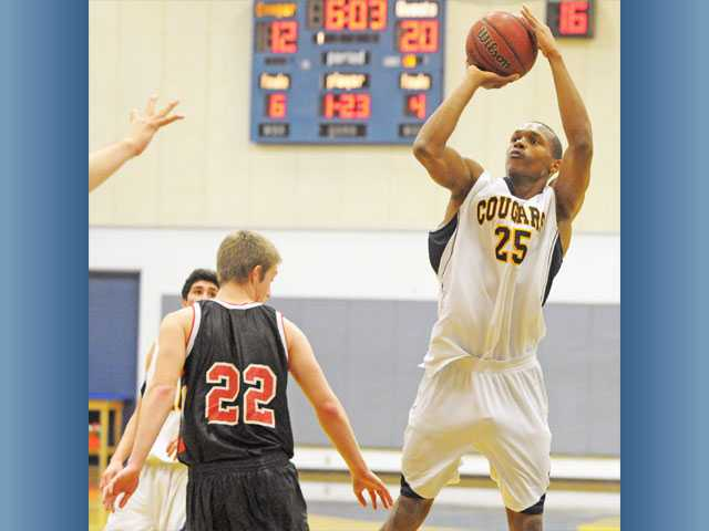 COC forward Ronald Harris (25) fades away for a shot against Palomar on Wednesday at the Cougar Holiday Classic.
