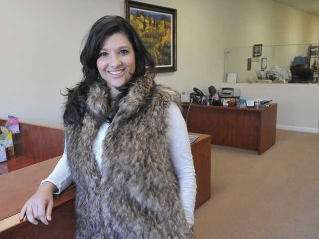 Erika Kauzlarich-Bird of Triple D Realty stands in her office in Santa Clarita on Dec. 21.