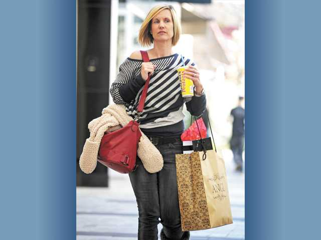 Tracy Franco, of Valencia, shops at Westfield Valencia Town Center on Monday.