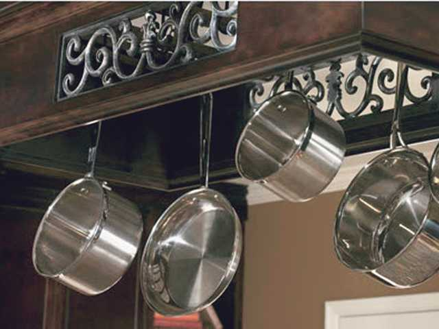 An overhead pot rack is a very efficient use of space.
