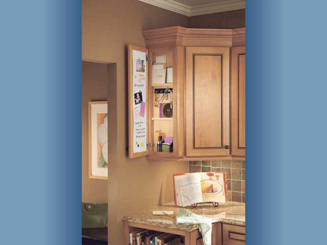 A wall message center in the kitchen can be closed when guests arrive.