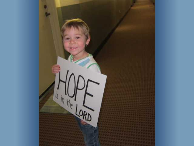 A young member of NorthPark Community Church celebrates his message of hope during the Valencia church's Hope Challenge.