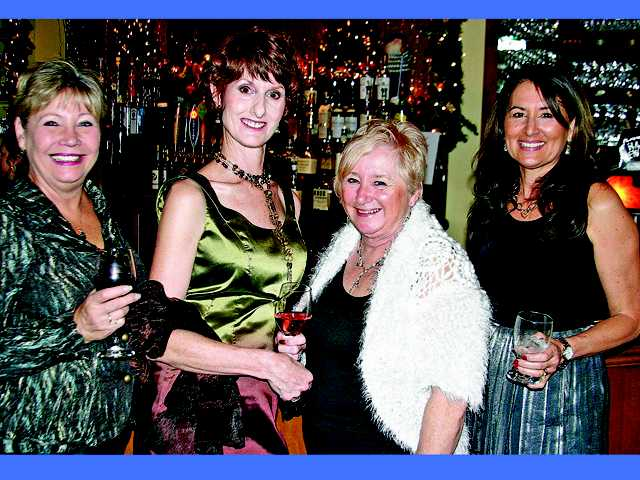 Circle of Hope Board member Peggy Edwards with COH founder Colleen Shaffer, Event Chair Chris Miller and Treasurer Theresa Stewart at the organization's New Year's Eve gala and fundraiser.
