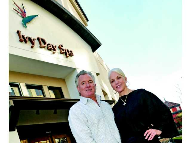 Owner Eric Smith, with Faye Morse, in front of The Ivy Day Spa on Town Center Drive in Valencia.