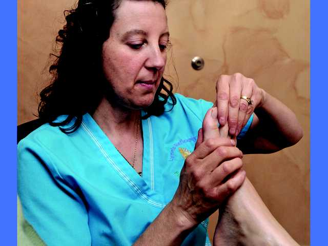 Lynn Tigar, of Lynn's Reflexology in Newhall, performs reflexology. Tigar was inspired to become a reflexology practitioner after her mom experienced side effects from medication. Searching for a more natural alternative, Tigar learned reflexology, which she has done for the last five years.