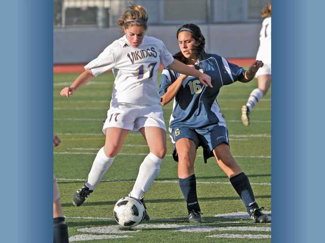 Valencia sophomore midfielder Rebecca Harrison, left, will factor heavily into the Vikings' scheme this year.
