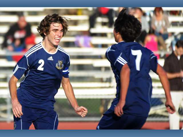 West Ranch's Chris Tumasone (2) celebrates his second goal with Connor Ashlock on Tuesday at Hart High.