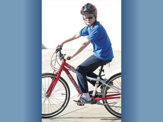 Adam rides his bike on a warm winter day.
