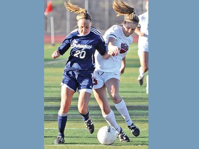 Saugus' Avery Schulhofer (20) and Hart's Danica Morgan battle for possession of the ball on Friday at Hart High.