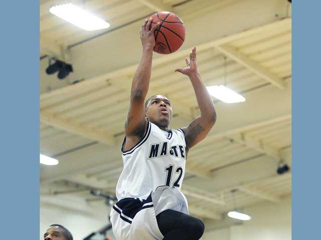The Master's College guard Mike Harmon elevates for a layup against Vanguard on Saturday at Bross Gym.