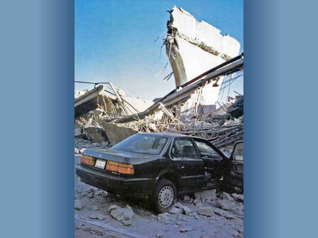 A car sits amid rubble in the Newhall Pass after an earthquake on Jan. 17, 1994.