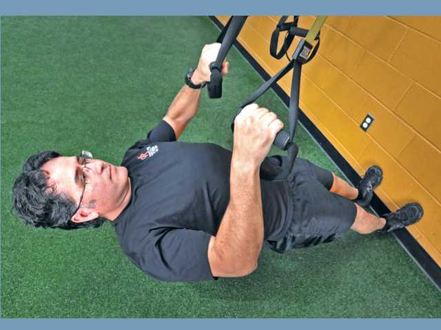 Quinonez performs an inverted row on the ATX equipment.