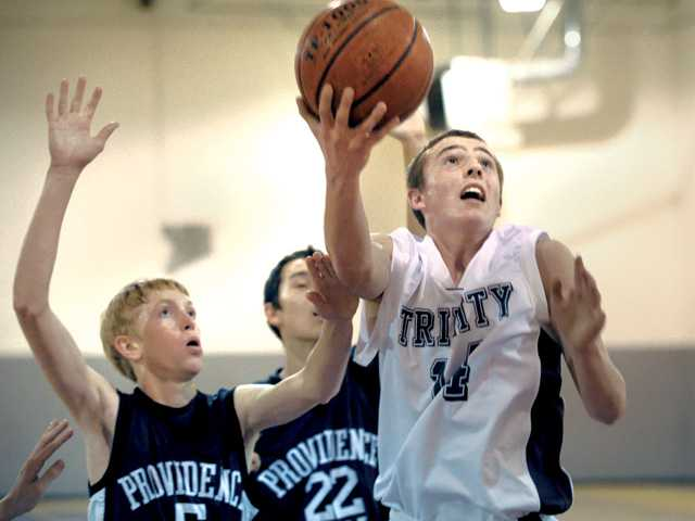 Prep basketball: Trinity halts the advances