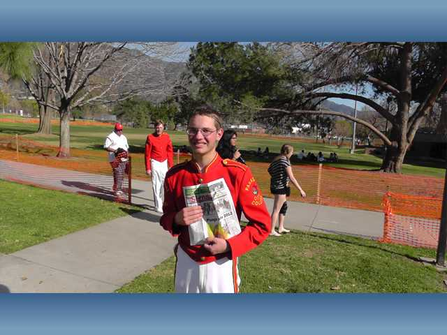 Kenneth Eernisse, a junior at Hart High School, holds a copy of The Signal in Pasadena after the 2012 Rose Parade. The Valencia resident played baritone horn for the Pasadena City College Tournament of Roses Honor Band in the parade.