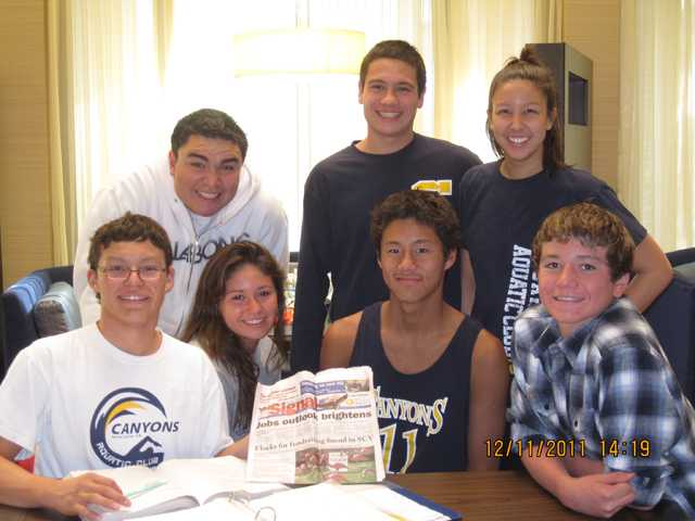 Members of the Canyons Aquatics Club attended a swim meet in Palm Springs on Dec. 12. Back row, from left: Christian Farfan, Kris Korth, Christine Lusk. Front row, from left: Nelson Guzman, Nicolette Barriero, Quincy Liu, Austin Barriero.