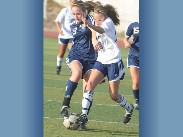 West Ranch's Nicole Leggat, left, and Saugus' Avery Schulhofer fight for possession of the ball on Friday at Saugus High School. Saugus won the game 2-1.