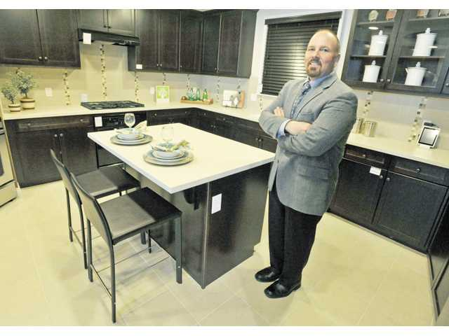 Tom DiPrima stands in a model kitchen at the KB Home Studio in Valencia.