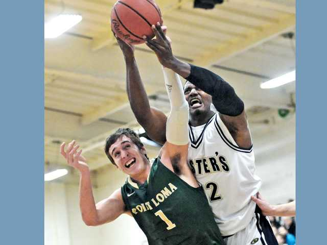 The Master's College center Paul Brown, right, fights for a rebound with Point Loma Nazarene University defender Hayden Lescault on Saturday at TMC.