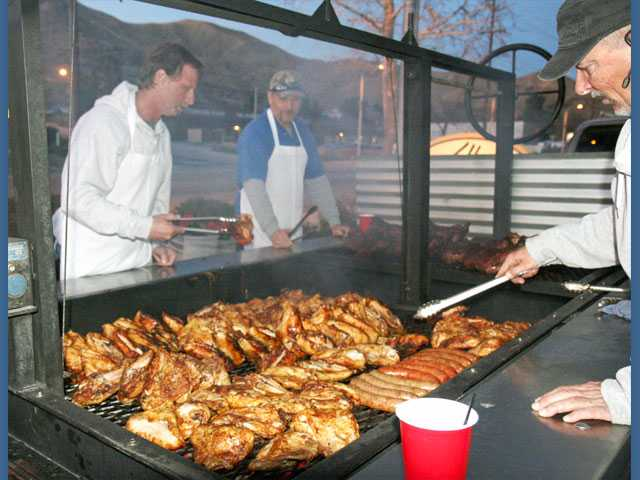 The Elks Barbecue Committee at work outside the clubhouse on Sierra Highway in Canyon Country.