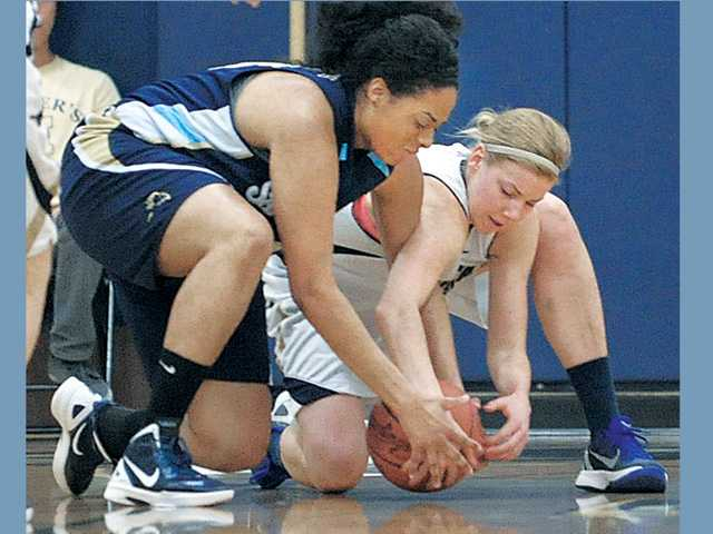 Women's college basketball: Heartbreaker for TMC