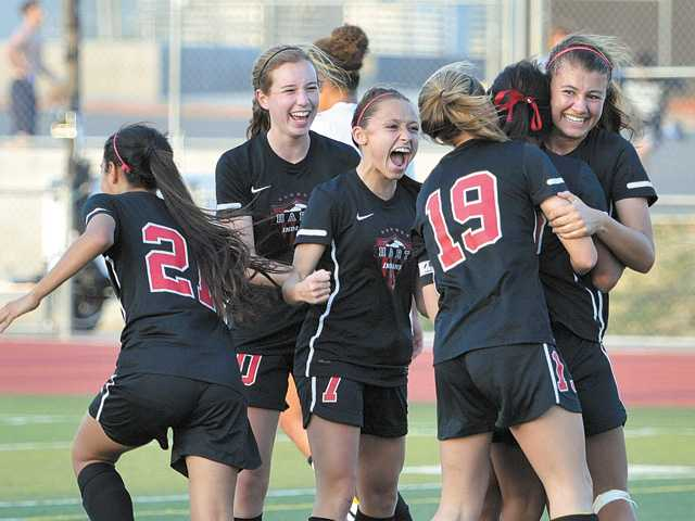 Hart High girls soccer players, from left, Allyssa Perez, Hailey Jenkins, Sophia Cortes, Danica Morgan, Jenny Chavez and Kelsey Steck, celebrate after scoring the go-ahead goal against Saugus on Tuesday at Saugus High.