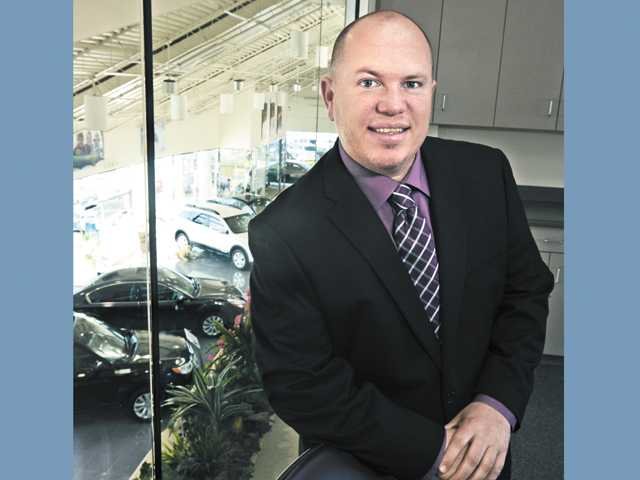 David Gillum Jr., general manager of Galpin of Santa Clarita, poses at the Valencia dealership.