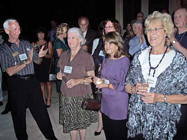 Guests applaud Jacquie Petersen, second from left, 2010 Guardians of Hope honorary chair.