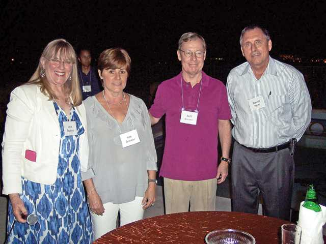 Left to right, Lois Bauccio, Kim and Jeff Greiner and Darrell Paulk at Guardians party.
