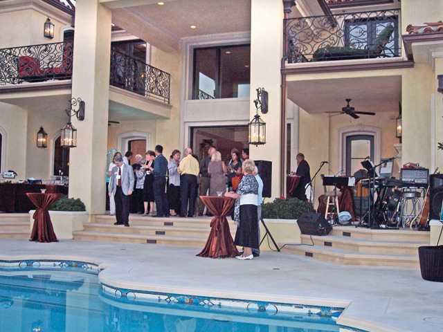 Guests gather in the backyard for hors d'oeuvres and music at the Westridge home of Jeff and Kim Greiner to celebrate the Santa Clarita Child & Family Center Guardians of Hope fund.