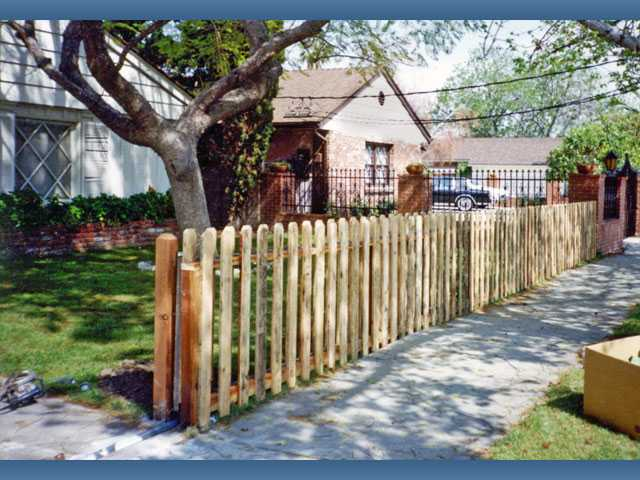 Wooden picket fencing adds an old-fashioned decorative touch to front or side yards.