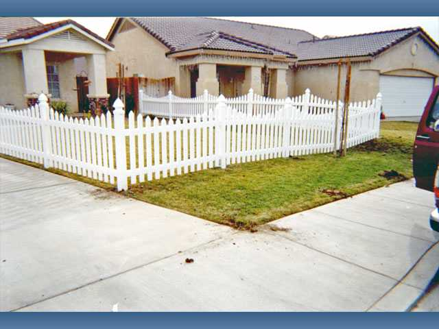 "Vinyl picket fencing with ""swoops"" is one option for fencing in your front yard."
