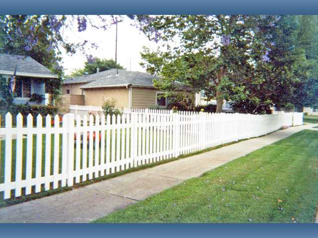 "Vinyl picket fencing without ""swoops"" is another attractive front-yard fencing option."