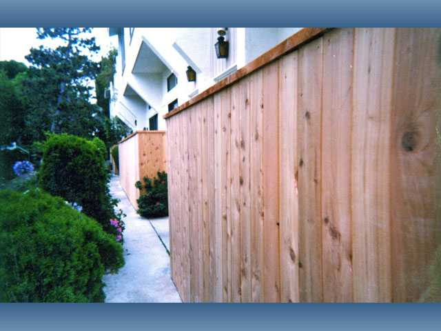 Redwood tongue-and-groove privacy fencing is a good solid fencing option.