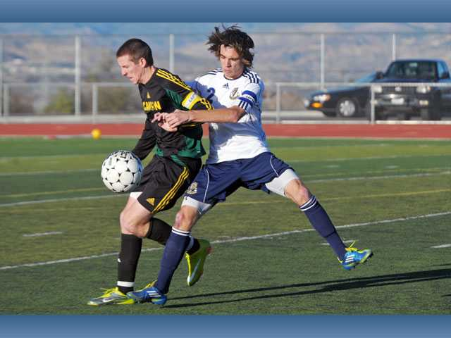 Canyon defender Alex Prince, left, keeps the ball from West Ranch's Chris Tumasone on Friday at West Ranch High. Canyon defeated the Wildcats 2-1.