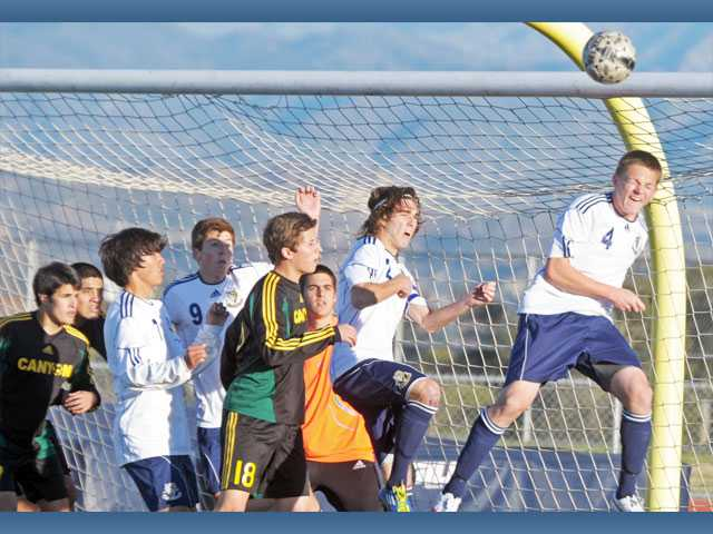 West Ranch's Brett Karson, far right, heads the ball away from Canyon's goal on Friday at West Ranch High. Canyon won 2-1.