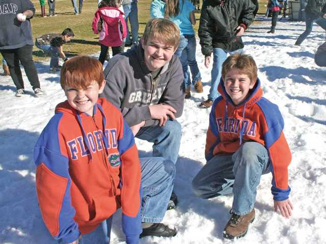 William Ross, Jonathan Ross and Student Council president Ethan Ross play in the snow.