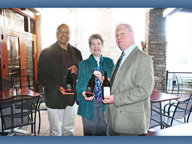 Left to right, Jim Ventress, chief professional officer for Boys & Girls Club of SCV and Terry and Carl Kanowsky, hosts of the benefit wine tasting.