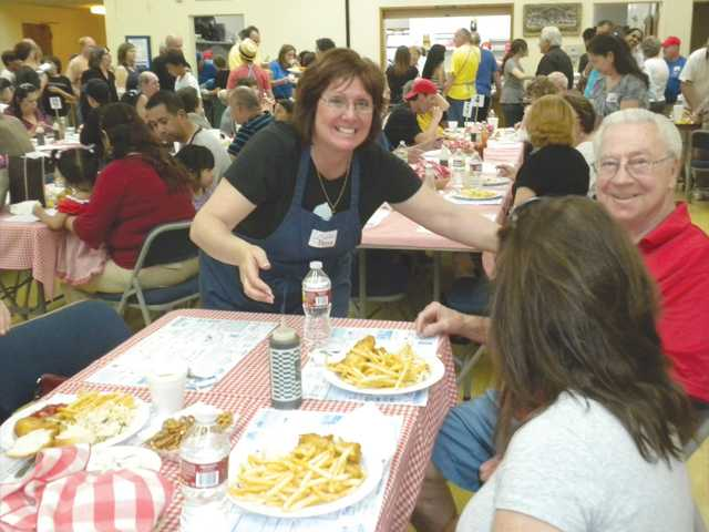 Donna Manfredi provides service with a smile at the 2011 St. Clare's Catholic Church Fish Fry.