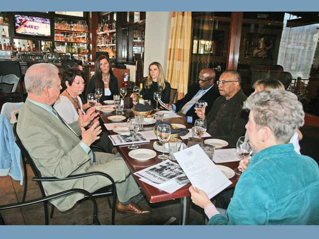 Left to right, Carl Kanowsky, Tamra Levine, Rhonda Chobanian, Jennifer Chadwick, Morris Thomas and Jim Ventress attended a pre-event wine tasting at Salt Creek Grille.