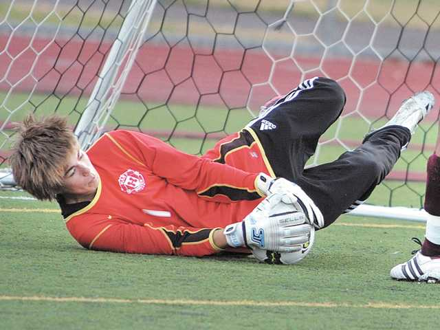 Hart boys soccer goalkeeper Mathew Ortiz stops a shot on Dec. 15. His team can win a league title with a victory over Canyon today. Hart owns a one-point lead over the Cowboys.