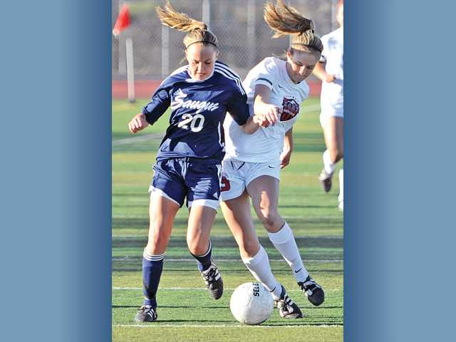 Saugus Avery Schulhofer (20) and Hart's Danica Morgan battle for the ball at Hart High on Jan. 31.