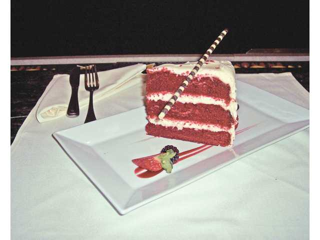 Red Velvet cake with a chocolate straw. There's always something special for dessert at The Oaks Grille at the Tournament Players Club in Valencia.