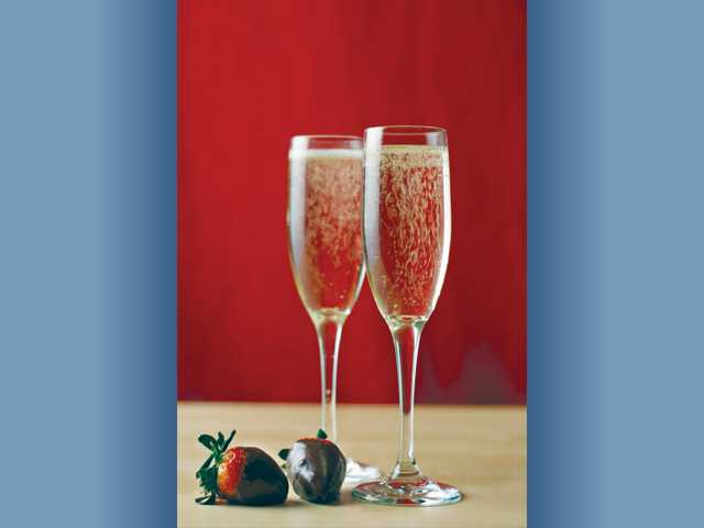 Set a romantic mood for Valentine's Day or any special occasion with champagne and chocolate.
