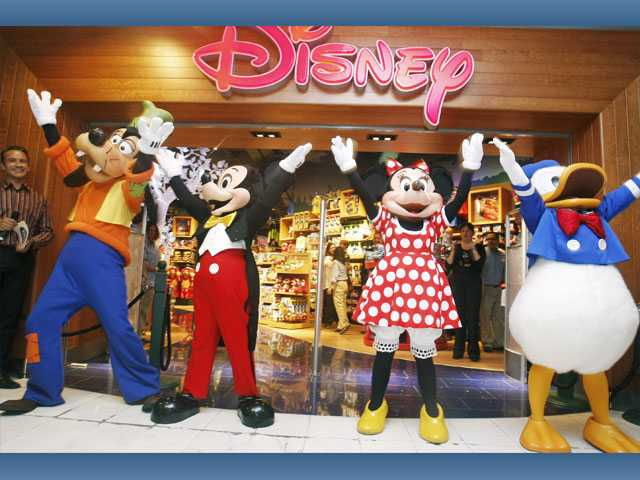 Disney characters celebrate the remodeling of a Disney Store. Disney will remodel stores in 12 countries this year.