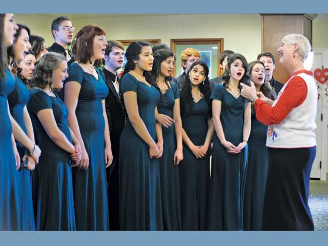 "Musical director Mary Purdy, right, leads the Canyon High Madrigals as they sing ""My Romance"" for a group of seniors at Summerhill Villa Senior Living in Santa Clarita as part of Canyon High's Sweetheart Serenades program for Valentine's Day on Tuesday."